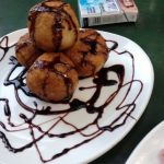 Yucca Balls filled with cheese with chocolate sauce in Tulum