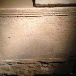 Roman memorial stones reused in a wall.