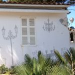 Painted shadows on a house.