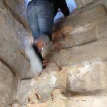 Jamie climbs the obelisk.