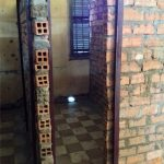 Prison cell. They were kept here for months. Shackled.