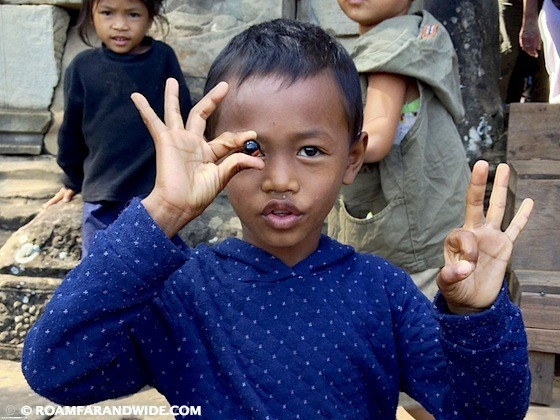 Boy with a marble near Angkor Wat, Cambodia