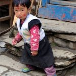 Adorable girl in a tiny village.