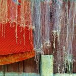 Fishing nets outside a home.