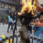 Flaming statue. The smoke from the fire is believed to help ailments.