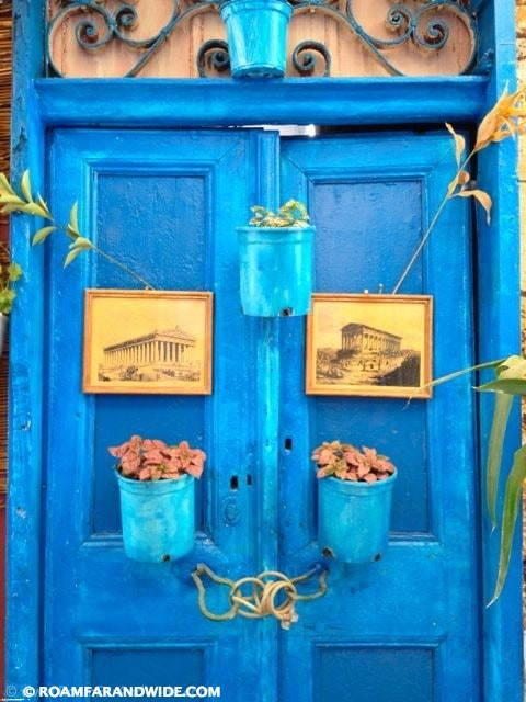 Photo of a door with photos from Athens in Chania's old town