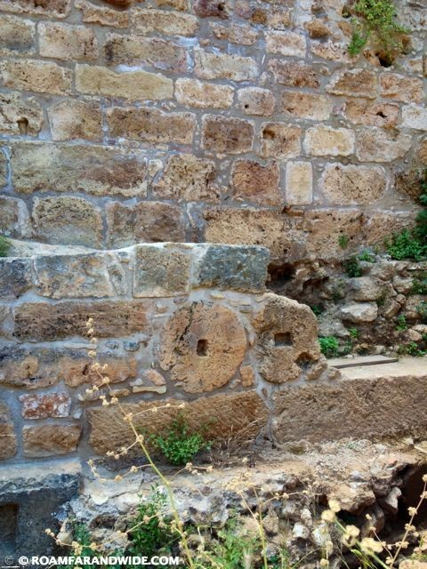 Image of Ancient walls with a millstone in Chania's old town