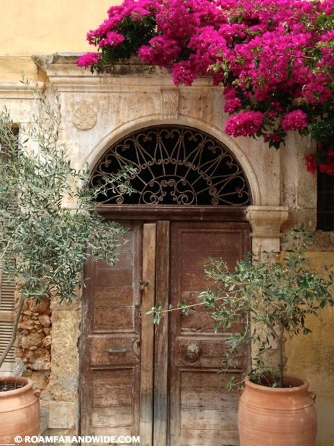Beautiful door with olive trees in Chania's old town