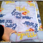 Rolling donated sleeping bags. This one, with an ironic message: Make Love, not War