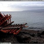 Refugee boat on the shore