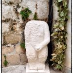 Peeing statue