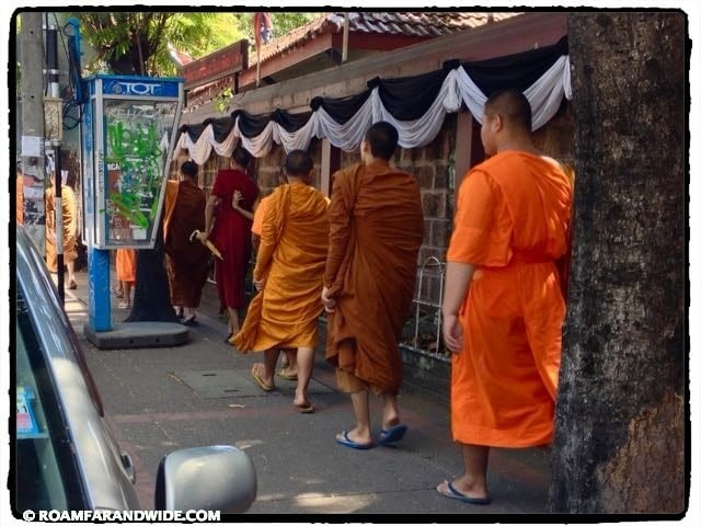 Monks walking to temple