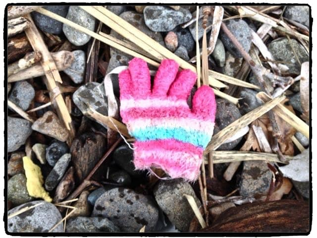 Child's mitten on the beach